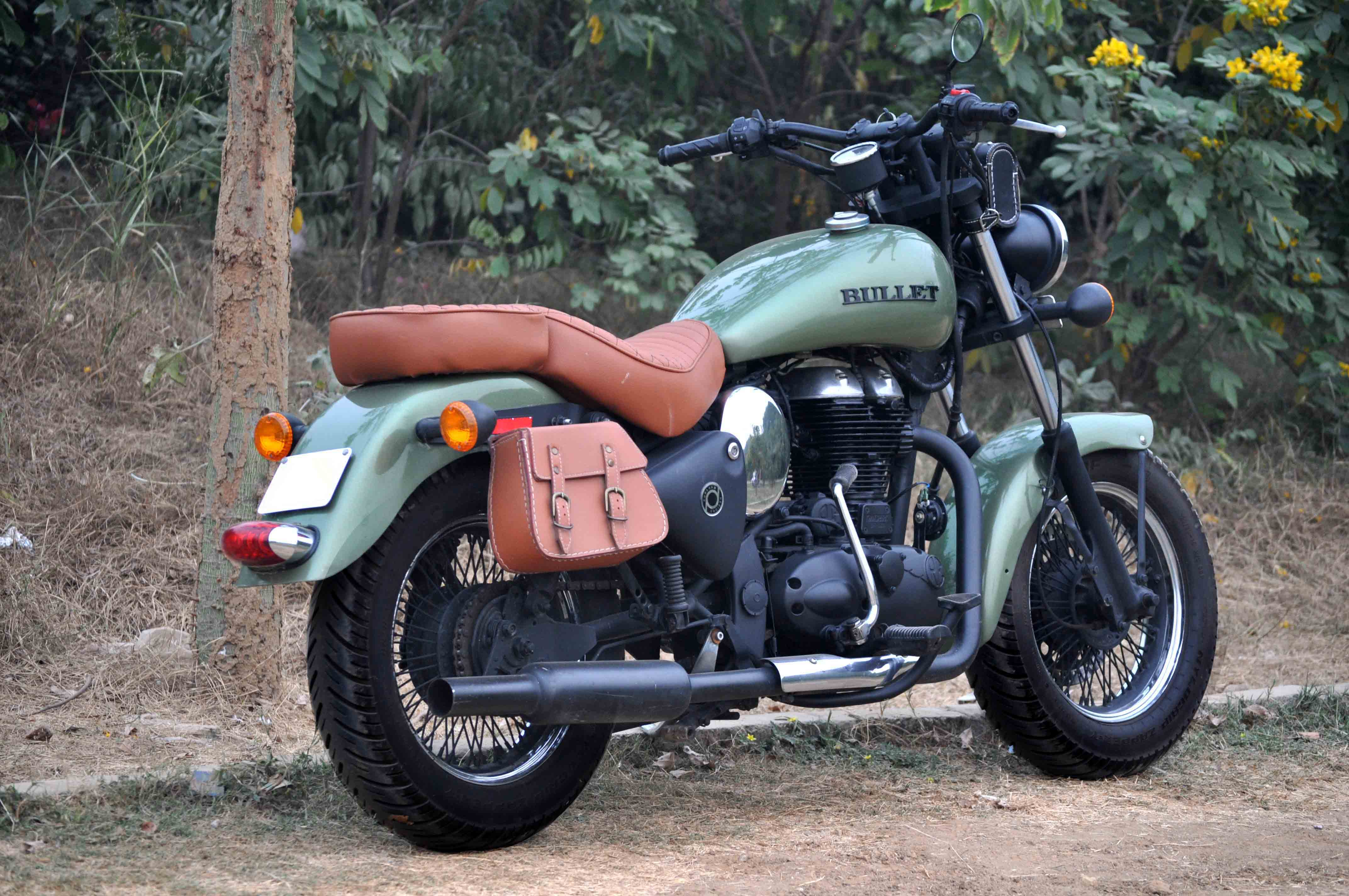 Modified Royal Enfield Classic 500 (battle green) by Puranam Designs